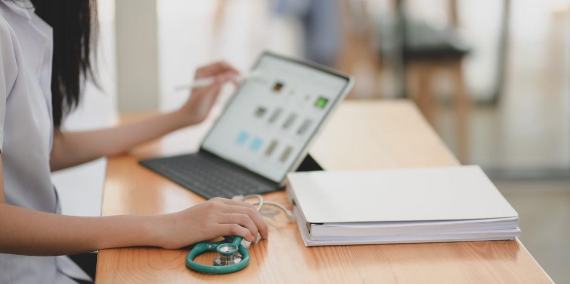 laptop computer open with medical healthcare law webinar