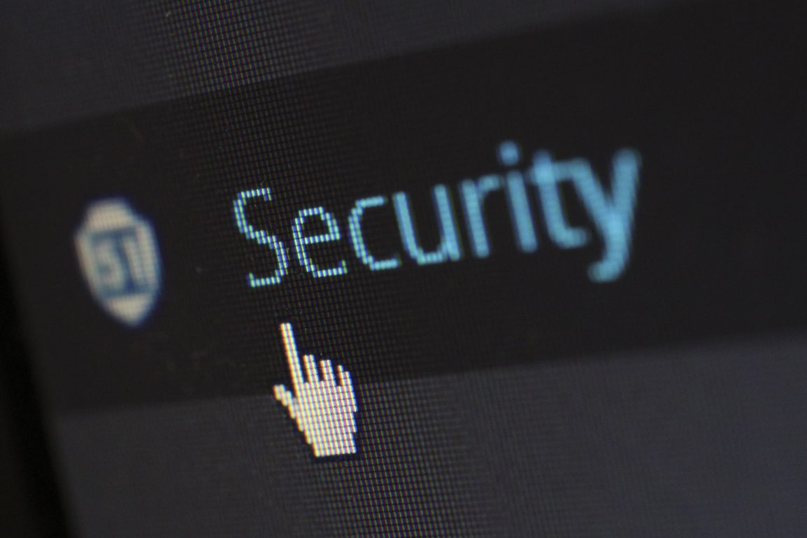 mouse clicker pointing to the word security